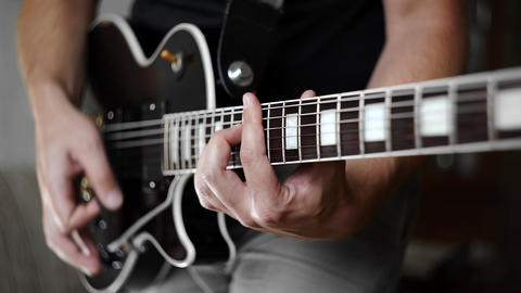 Man's hands playing the funky rhythm on electric guitar, electric musical Footage