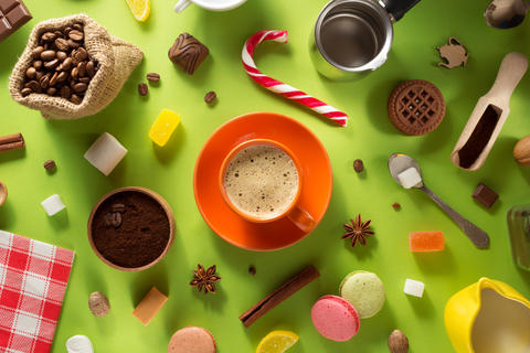 cup of coffee and ingredients at colorful background Photo