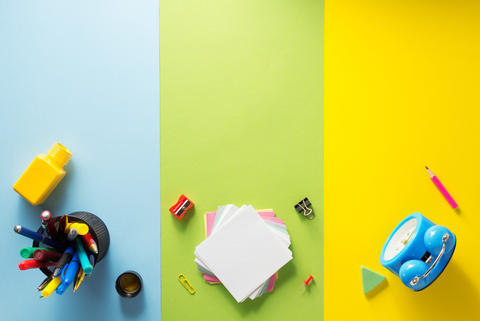 school supplies at abstract colorful background フォト
