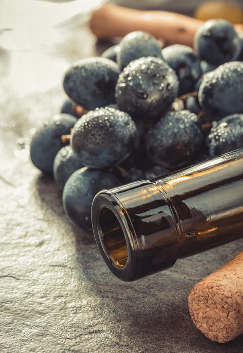 grapes and wine bottle Photo