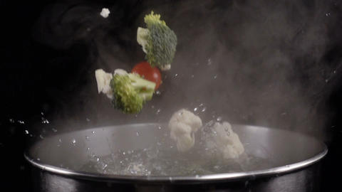 Throwing vegetables into boiled water Footage