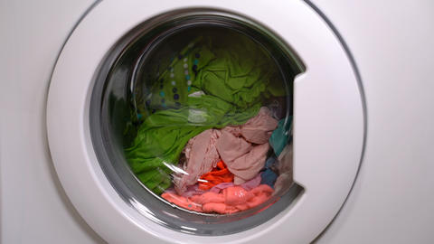 Washing machine is washing clothes Footage