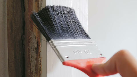Closeup slow motion footage of painting old wooden board with paint brush Footage