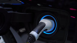 plugging power cord to an electric car GIF