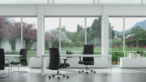 Empty modern office with tables and chairs, garden outside the window Footage