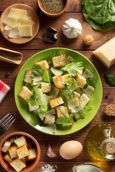 caesar salad in plate at wood Photo