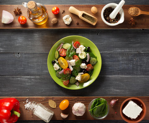 fresh greek salad in plate and ingredients Photo