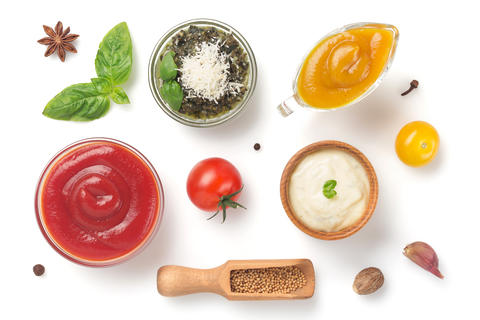 set of dip sauces in bowl on white Photo