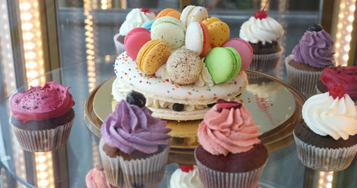 Cupcakes and Macarons in a shop window in the confectionery Footage