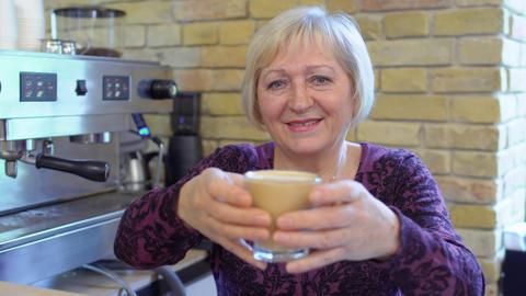 Granny barista present her first cappuccino 영상물