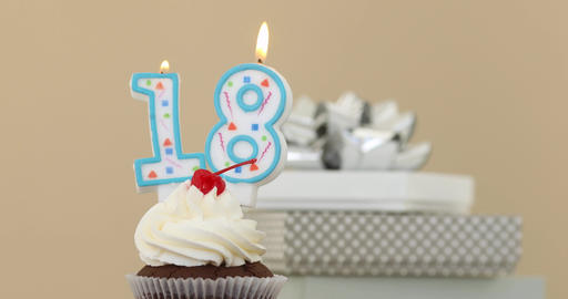 Eieghteen 18 candle in cupcake pastel background Live Action