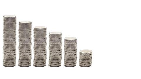 Nine stacks of coins decreasing - Stop Motion Footage