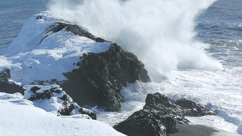 Rough waves splash at volcanic rocks in the Atlantic Ocean Live Action