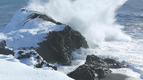 Rough waves splash at volcanic rocks in the Atlantic Ocean Footage