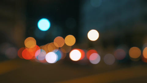 Busy big city defocused night traffic lights real camera bokeh blur - 4k Footage