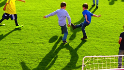 Children Playing Football In Slow Motion stock footage