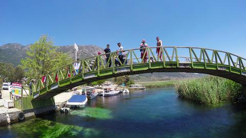 AZMAK RIVER, AKYAKA - TURKEY, MAY 2015: People on bridge Footage
