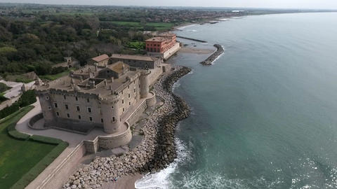 Aerial view of ancient castle on the beach - Castello Odescalchi Italy Footage