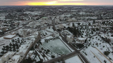 4k Aerial of Alberobello town in Italy, over looking houses covered by snow Footage