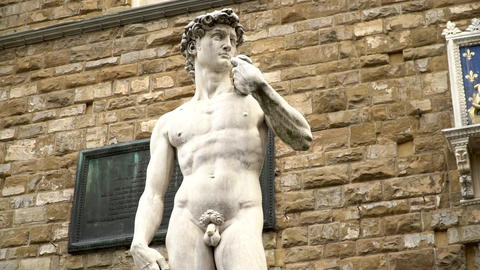 Close up to zoom out shot of David (Michelangelo) statue in Florence Footage