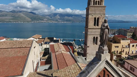Aerial shot orbiting church in Gaeta Italy, showing sea side and mountains Footage