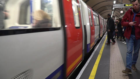 London Underground Train approaching station with people waiting Footage