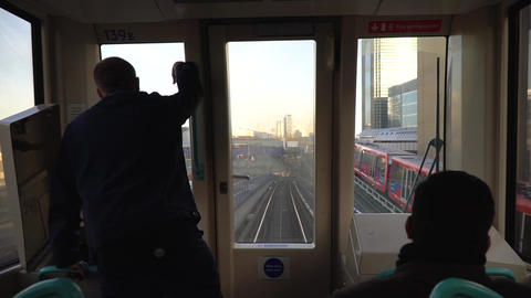 People traveling on London Overground train Live Action