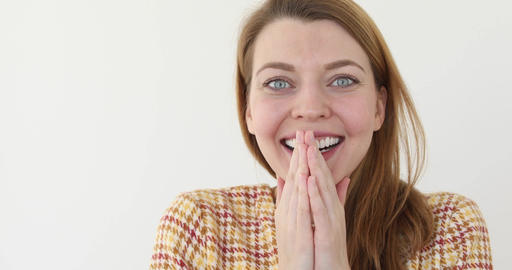 Shocked happy woman covering mouth isolated Live Action