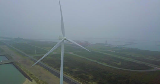 4k Aerial close up shot of a Wind Turbine Generator in The Netherlands Footage