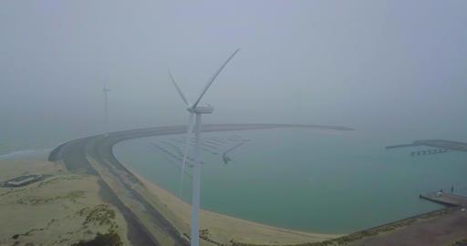 4k Aerial orbit of a Wind Turbine Generator in The Netherlands Footage