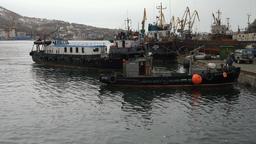 Touristic sea boat approaches the pier in seaport GIF