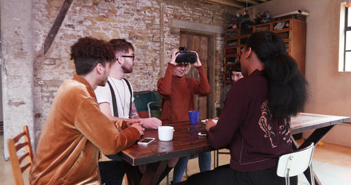 Group of young entrepreneurs in a meeting with VR headset Footage