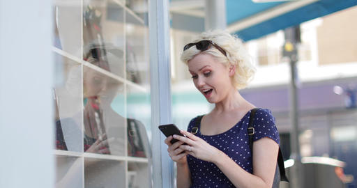 Young adult female using a smartphone whilst shopping Footage