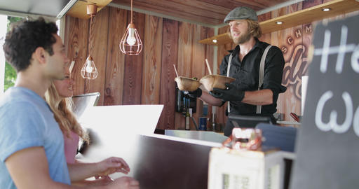 Food Truck owner serving customers healthy meal Footage