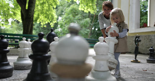 Mother and child playing chess Live Action