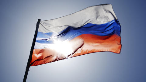 russian flag flying in slow motion and back lit by the sun Footage