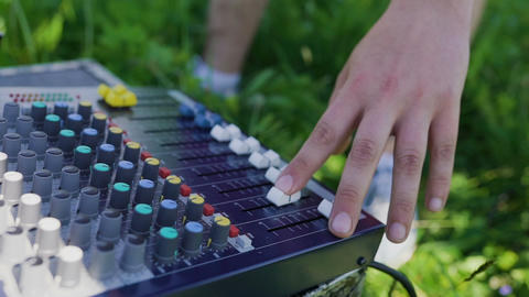 The sound operator adjusts the mixing console GIF