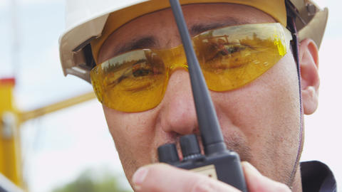 Worker Reports Information Using Portable Radio Footage