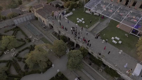 Aerial shot of people partying in a beautiful villa during sunset Archivo