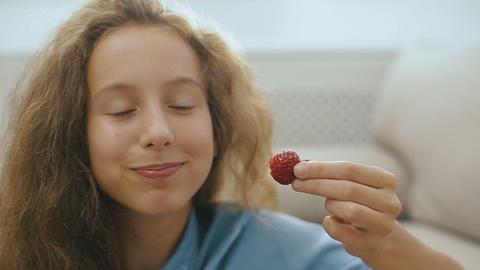 Beautiful teen girl with strawberry. Beautiful teen girl... Stock Video Footage