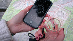 Traditional Analog and Digital Compass as the Phone App in the Female hands Footage