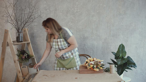 Woman choosing kraft paper for edible arrangement Stock Video Footage