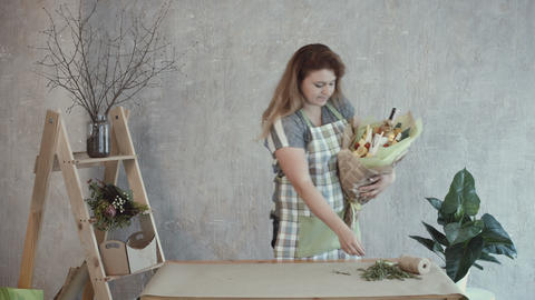 Woman decorating edible arrangement with herbs Footage