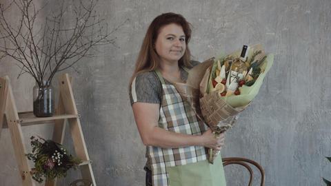 Smiling woman holding edible bouquet arrangement Footage