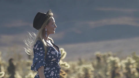 woman loses her hat from the wind, 4K Footage