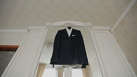 Suit jacket. The suit jacket hangs on the hanger in room, Live Action