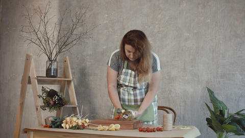Lovely woman making edible bouquet at workshop Footage