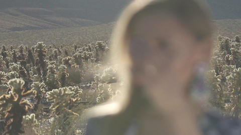 cute girl with long hair about desert cacti Live Action