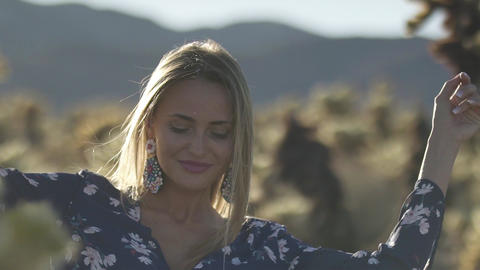 beautiful woman dancing among cacti in the desert Live Action