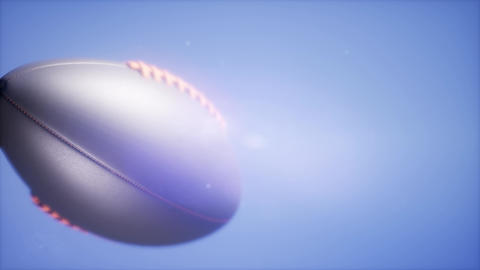 4K Super slow motion flying football on blue sky background 영상물